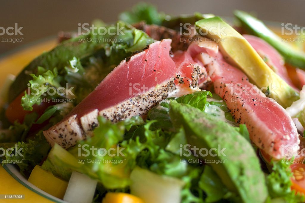 Pan-seared Tuna over salad. royalty-free stock photo
