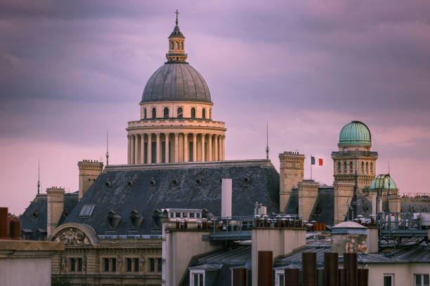 pantheon at dramatic dawn and french flag - paris, france - cupola stock pictures, royalty-free photos & images