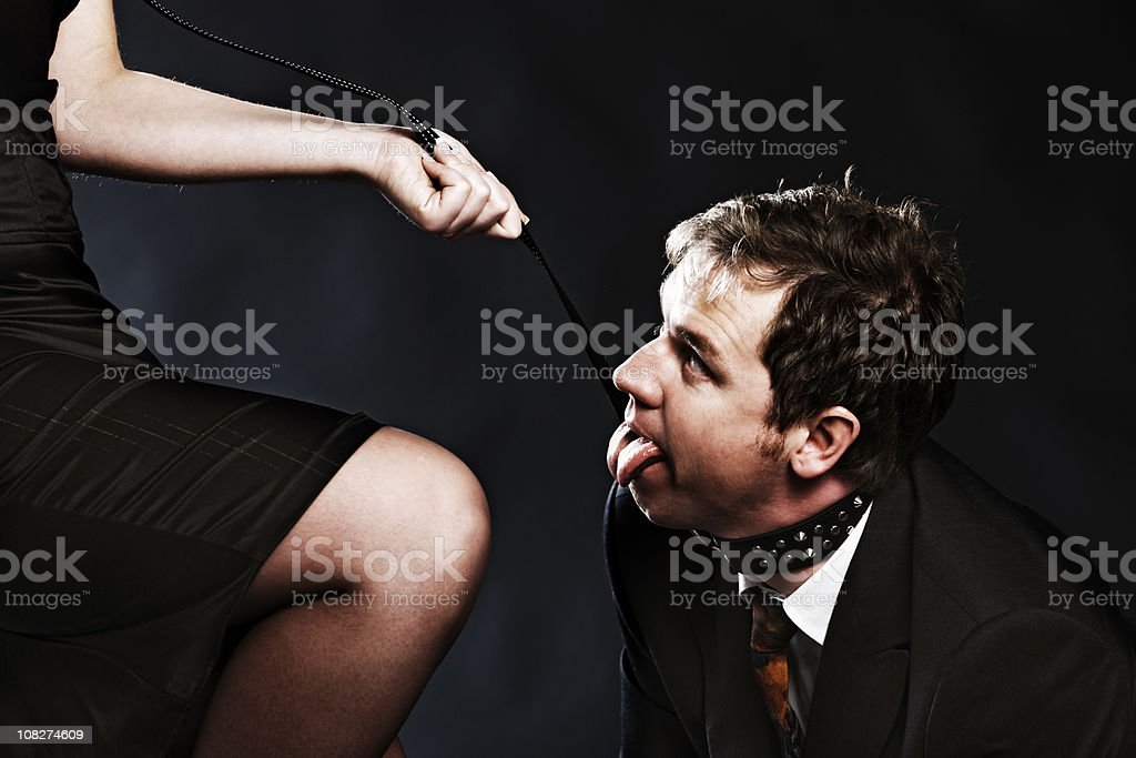 Panting businessman on a leash stock photo