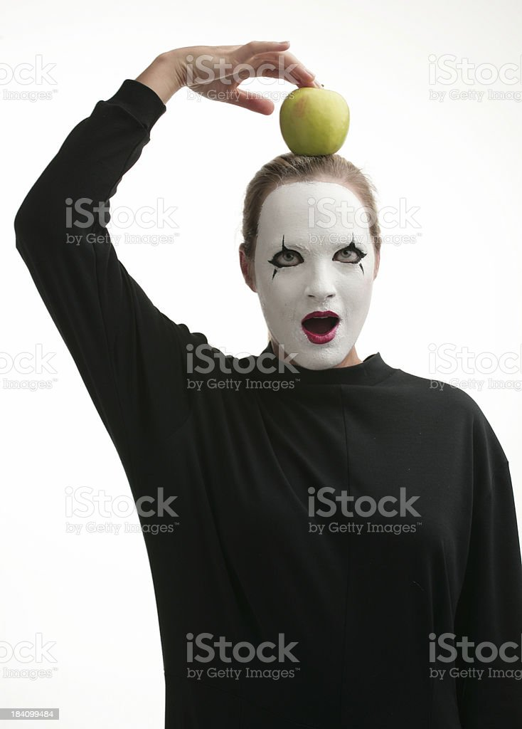Pantomime with an apple on head royalty-free stock photo