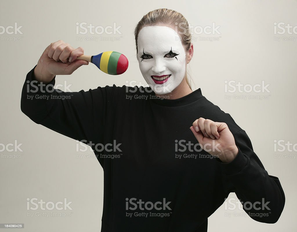 Pantomime with rattle toy royalty-free stock photo