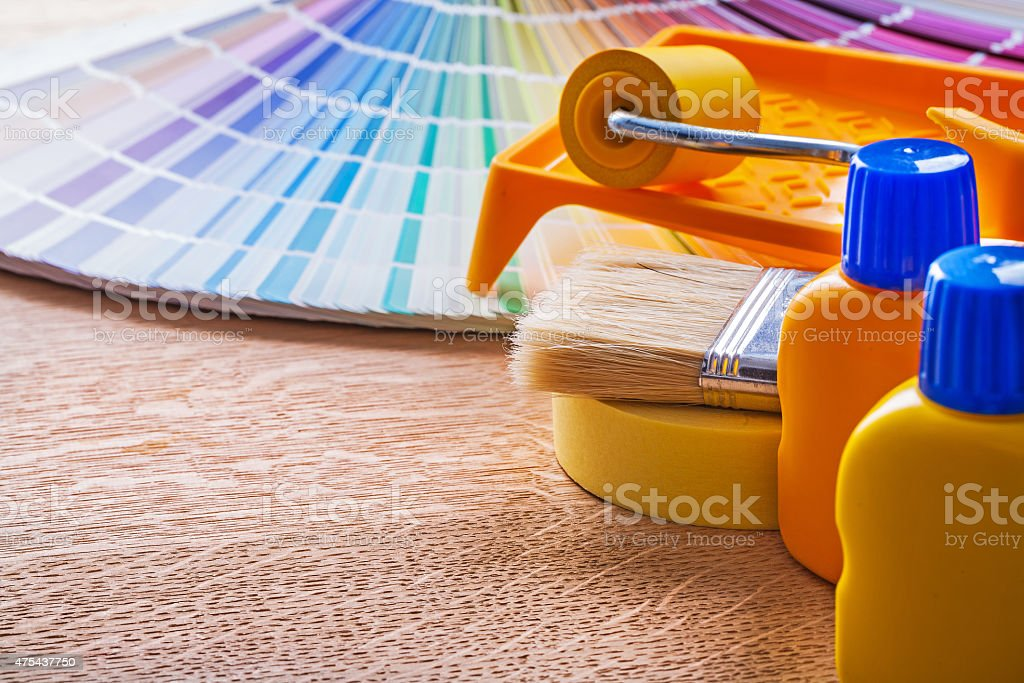Pantone fan and home improvement paint tools on wood board stock photo