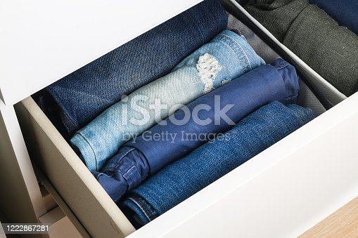 1222867278 istock photo Pants folded according to the method of Marie Kondo. Vertical storage of clothes in a chest of drawers. Storage organization. Order and cleanliness. Quarantine, self-isolation, housework. Accuracy. 1222867281