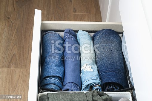 1222867278 istock photo Pants folded according to the method of Marie Kondo. Vertical storage of clothes in a chest of drawers. Storage organization. Order and cleanliness. Quarantine, self-isolation, housework. Accuracy. 1222867284