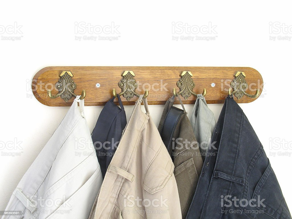 Pants hung on the hooks stock photo