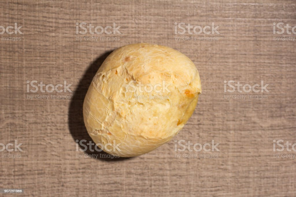 Pao de Queijo is a cheese bread ball from Brazil. Also known as Chipa, Pandebono and Pan de Yuca. Snack on wood table, flat design. stock photo