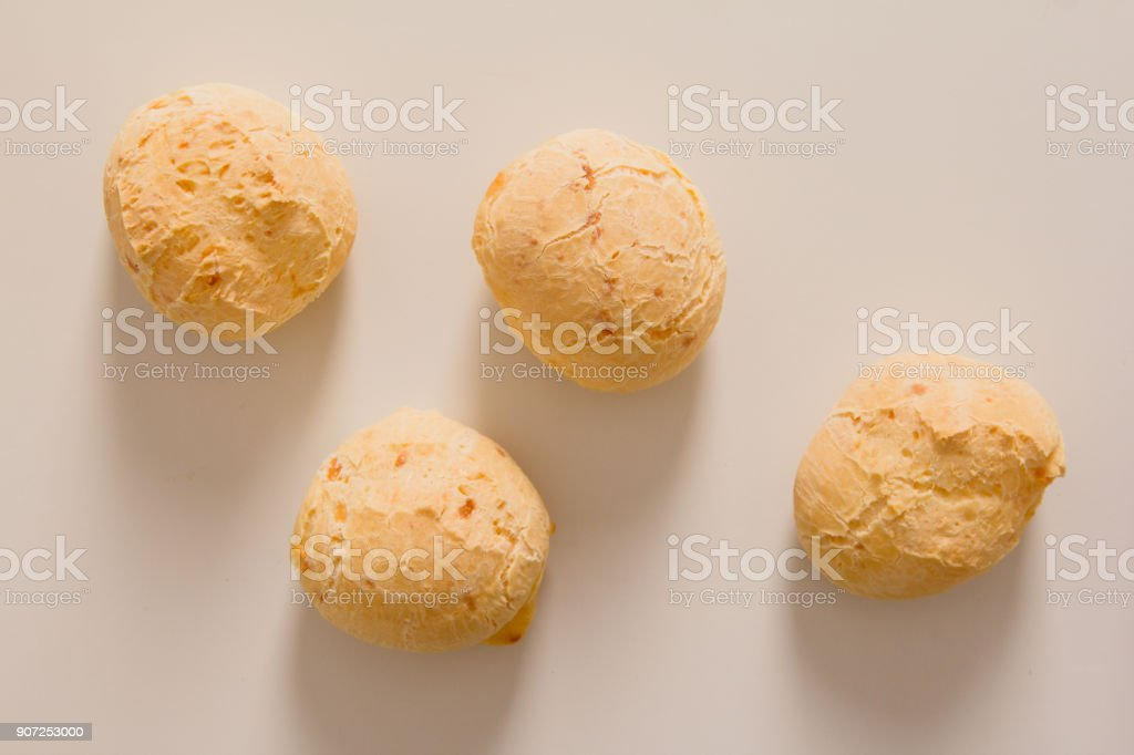 Pao de Queijo is a cheese bread ball from Brazil. Also known as Chipa, Pandebono and Pan de Yuca. Snacks over white background, minimalism. stock photo