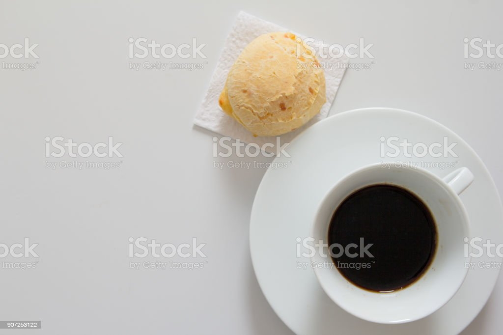 Pao de Queijo is a cheese bread ball from Brazil. Also known as Chipa, Pandebono and Pan de Yuca. Snack and espresso cup on white background, minimalism. stock photo