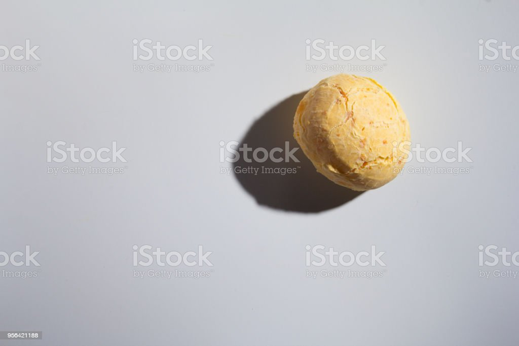Pao de Queijo is a cheese bread ball from Brazil. Also known as Chipa, Pandebono and Pan de Yuca. One snack over white background, minimalism. stock photo