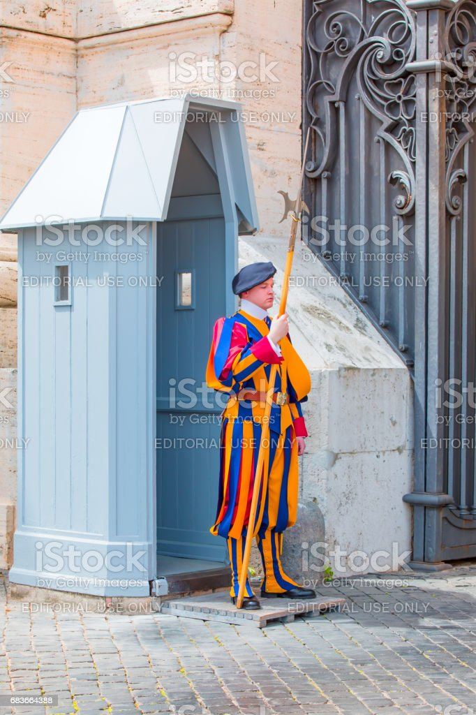 Papal Swiss Guard stands stock photo
