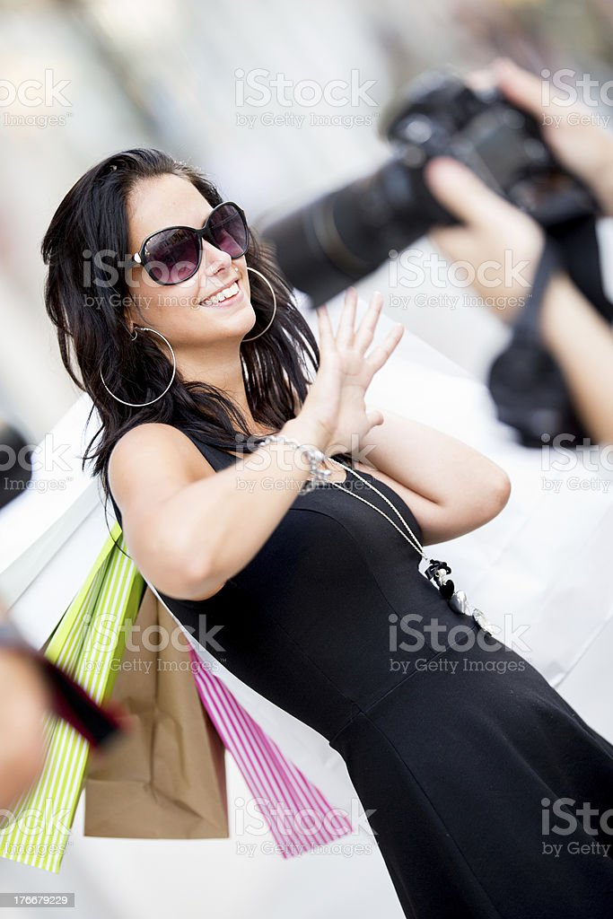 Paparazzi caught a celebrity during shopping. royalty-free stock photo