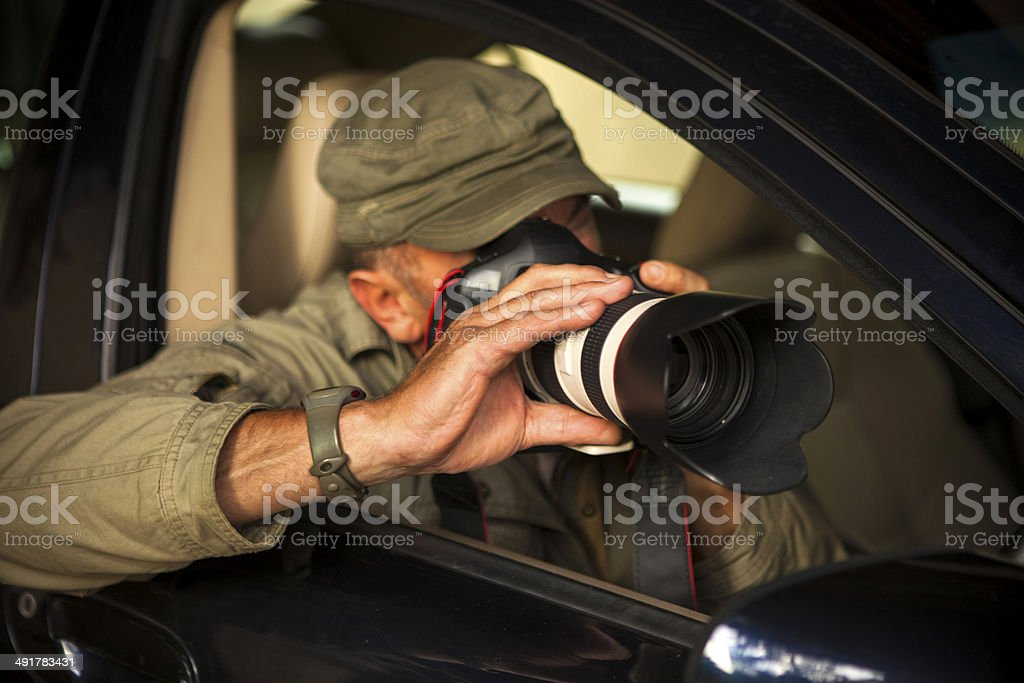 Paparazzi in action - shooting from car stock photo