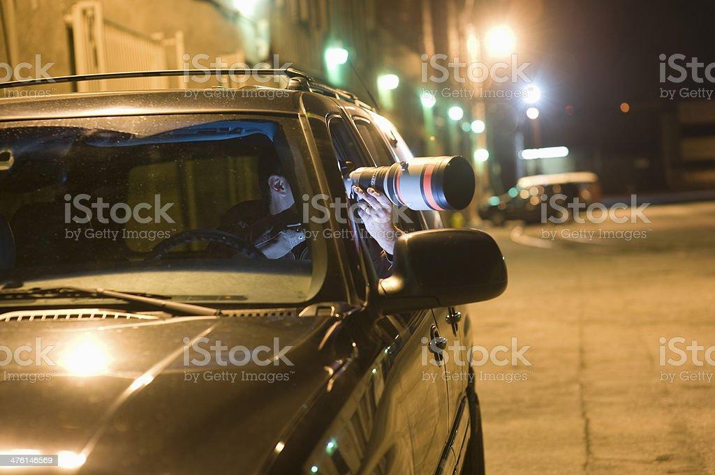 Paparazzi Photographer In Car stock photo