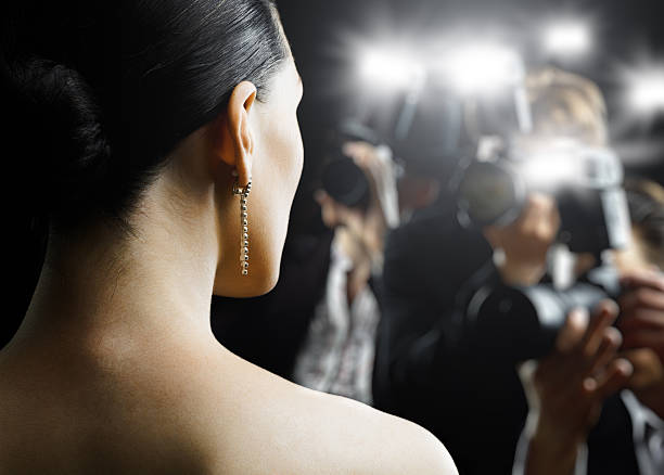paparazzi photographing a woman - celebrities stock pictures, royalty-free photos & images