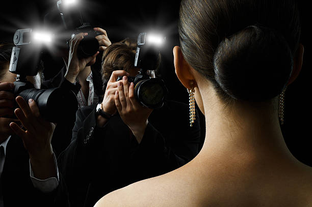 paparazzi Photographers are taking a picture of a film star diva human role stock pictures, royalty-free photos & images