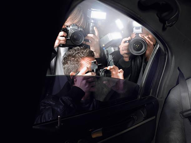 Paparazzi Shooting Through Car Window stock photo
