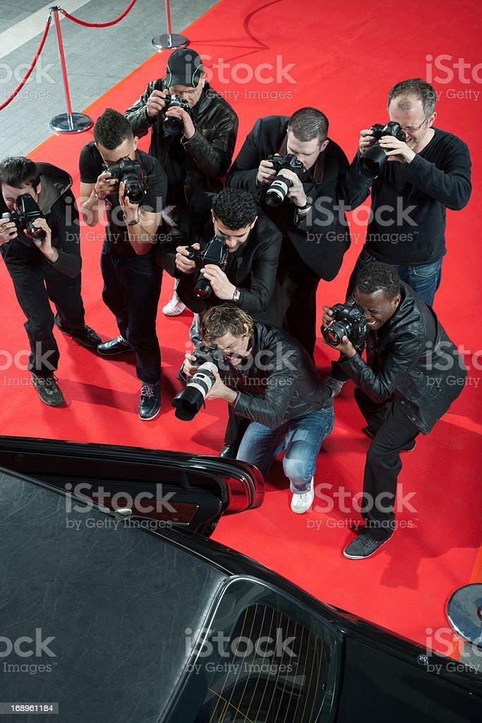 Paparazzi taking photos of celebrity's car royalty-free stock photo