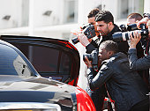 istock Paparazzi taking pictures of celebrity in car 130406988