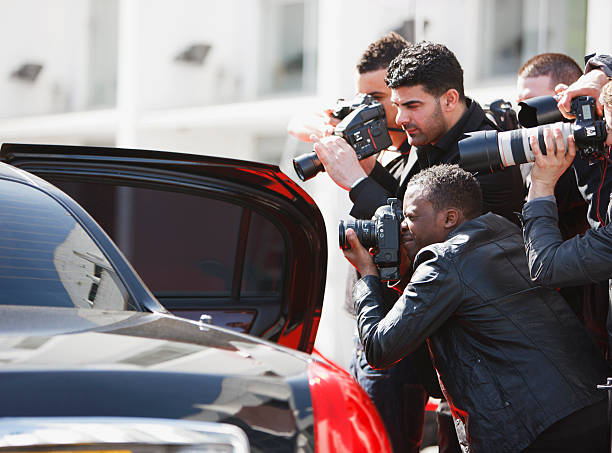 Paparazzi taking pictures of celebrity in car  fame stock pictures, royalty-free photos & images