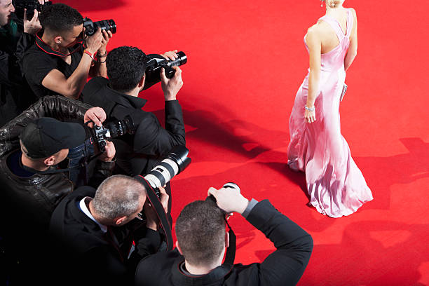 Paparazzi taking pictures of celebrity on red carpet picture id130407097?b=1&k=6&m=130407097&s=612x612&w=0&h=gn0ryrx0hlykblgqxtmbl6pmgki35h2cvi91pexaf y=
