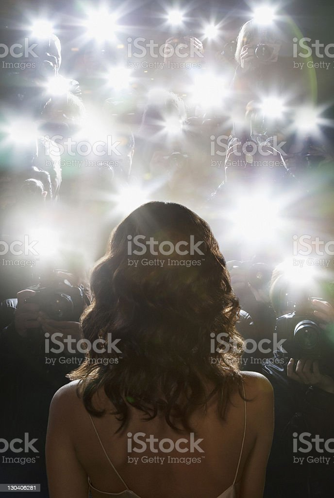 Paparazzi taking pictures of celebrity stock photo