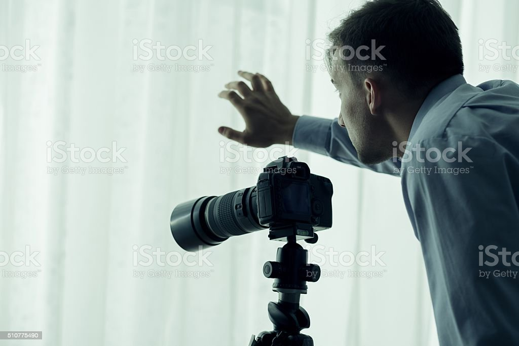 Paparazzi with camera stock photo