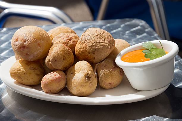 Papas Arrugadas with Mojo, pepper sauce - Traditional canarian dish stock photo