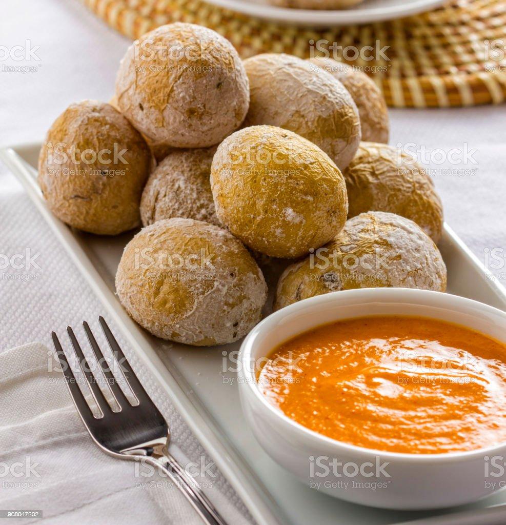 Papas arrugadas with spicy mojo sauce stock photo