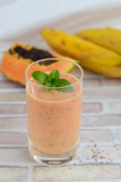 Papaya banana smoothie Papaya banana smoothie papaya smoothie stock pictures, royalty-free photos & images