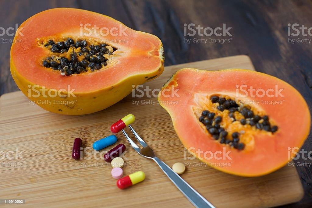 Papaya Fruit and Vitamins royalty-free stock photo