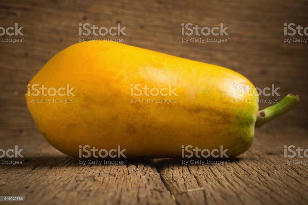 papaya fruit. old wooden. moring. sunset. art. asian stock photo