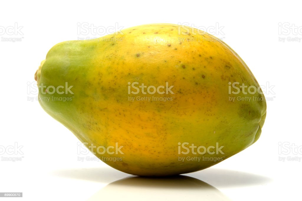 A papaya fruit on a white background with a little shadow royalty-free stock photo