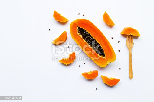 Papaya fruit on white background. Copy space