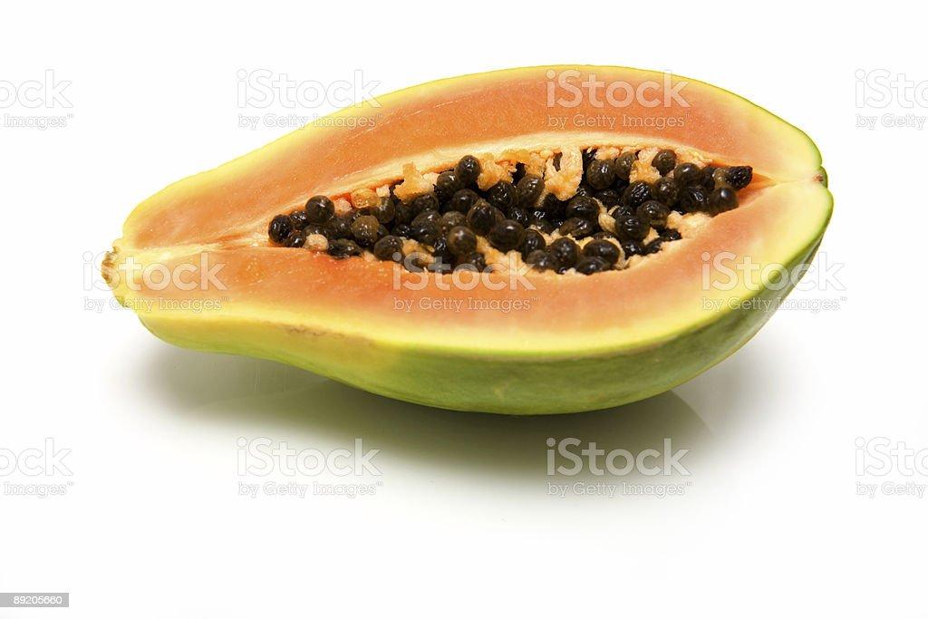 Papaya or paw-paw on a white studio background. royalty-free stock photo