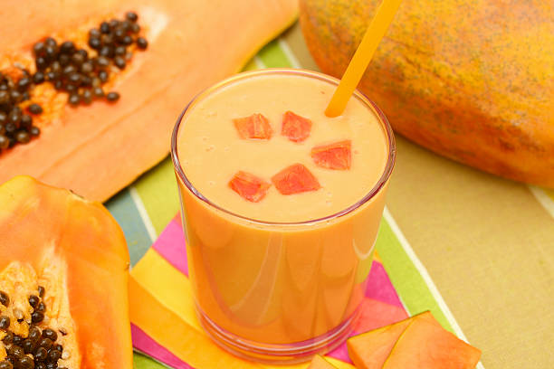Papaya smoothie Fresh papaya smoothie papaya smoothie stock pictures, royalty-free photos & images