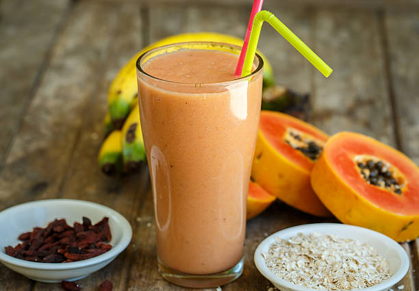 Papaya smoothie Papaya smoothie papaya smoothie stock pictures, royalty-free photos & images