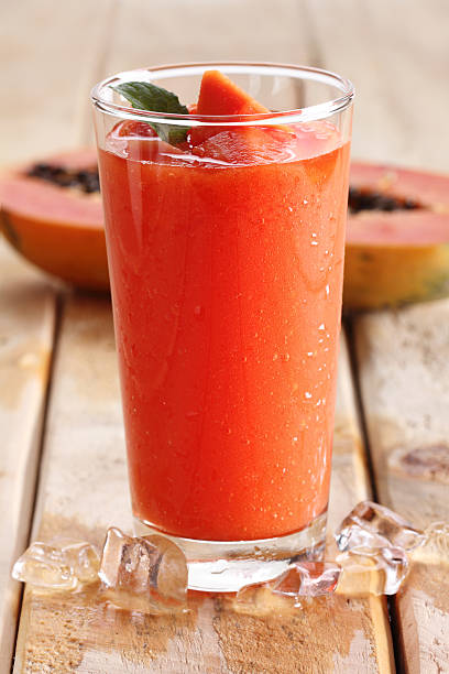 papaya smoothie healthy fruity smoothie with papaya in a glass papaya smoothie stock pictures, royalty-free photos & images