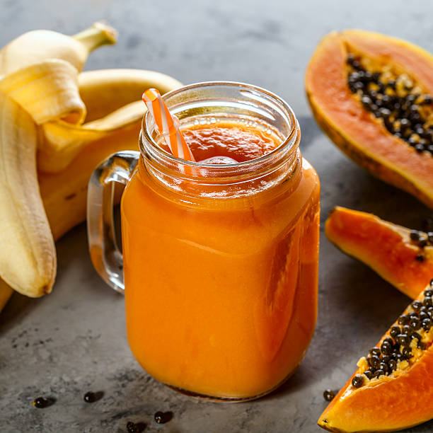 Papaya smoothie, selective focus. Detox, diet food. Papaya smoothie, selective focus. Detox, diet food, vegetarian food, healthy eating concept. papaya smoothie stock pictures, royalty-free photos & images