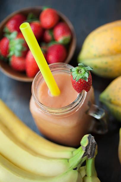 Papaya Strawberry Banana Smoothie stock photo