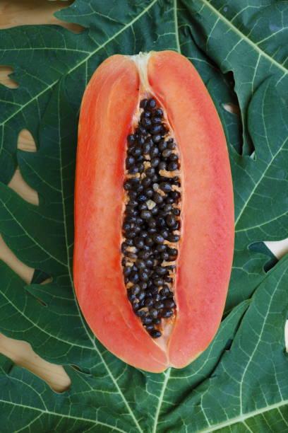 papaya_fruit_cut_half_b stock photo