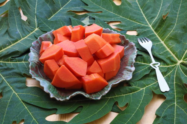 papaya_fruit_in_dish_with_a_fork stock photo