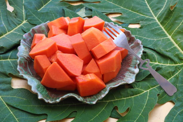 papaya_fruit_in_dish_with_a_fork_b stock photo