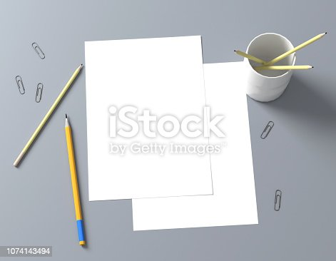 istock Paper A4 with pensil 1074143494