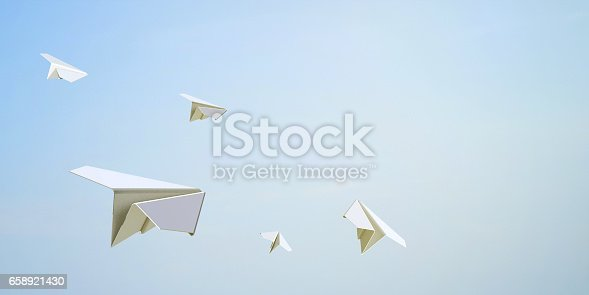 istock Paper Airplane Flying Freedom on Sky Background 658921430