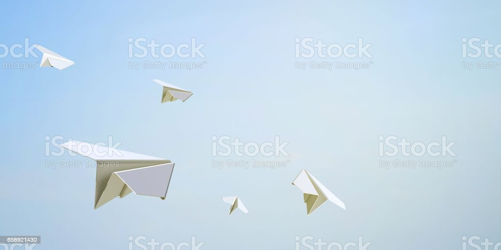 Paper Airplane Flying Freedom on Sky Background stock photo