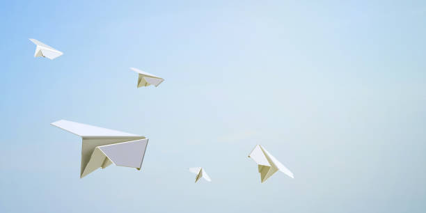 paper airplane flying freedom on sky background - paper airplane stock photos and pictures