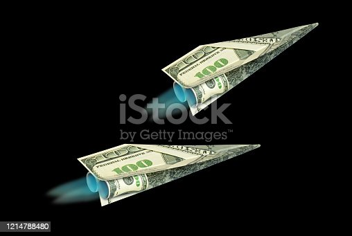 istock Paper Airplane from Dollar bills black isolated back ground 1214788480
