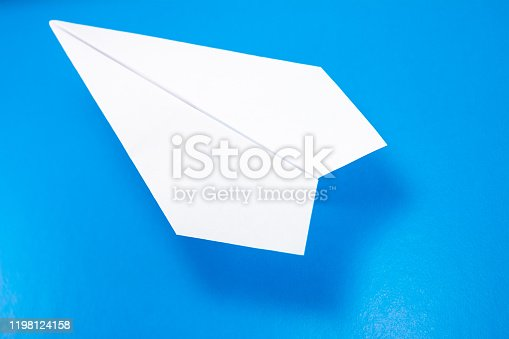 658921430 istock photo paper airplane made of white paper on a light blue background 1198124158