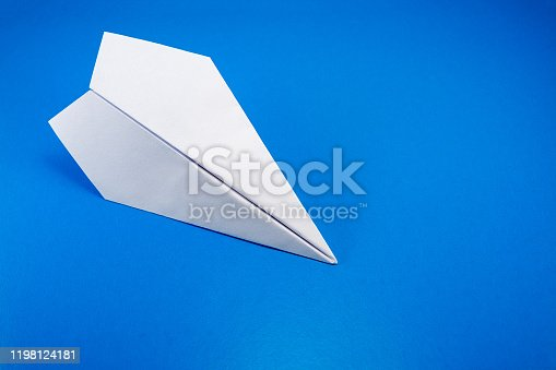 658921430 istock photo paper airplane made of white paper on a light blue background 1198124181