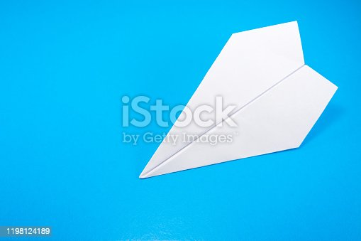 658921430 istock photo paper airplane made of white paper on a light blue background 1198124189